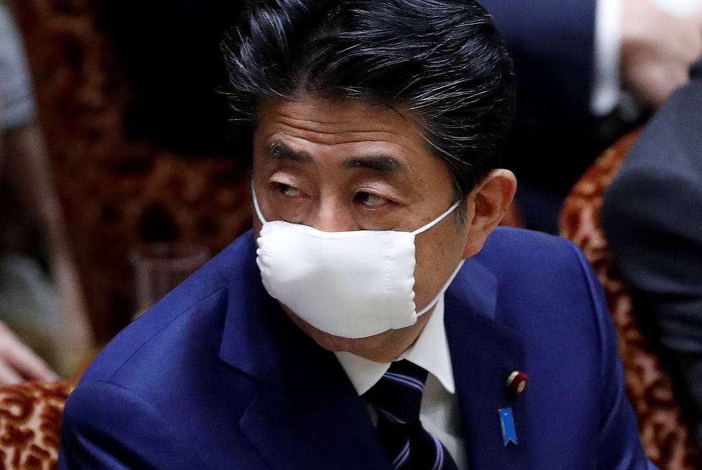 On brink of Covid-19 crisis, Japan PM offers masks, gets social media roasting