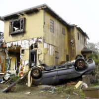 This house and car are believed to have been wrecked by a tornado in Ichihara, Chiba Prefecture, on Saturday morning.